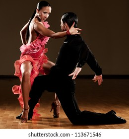professional latino dance couple in action - dancing passionate samba or wild passodoble