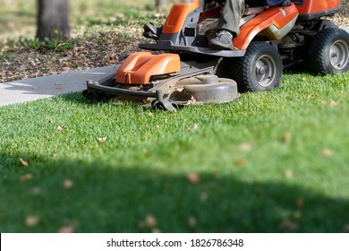 Professional lawn mowing machine. Summer and autumn season sunny lawn mow in the garden