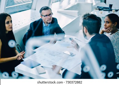 Professional lawyers of company solving problems discussing strategies during working process, business partners having conversation about financial reports checking budget numbers and incomes