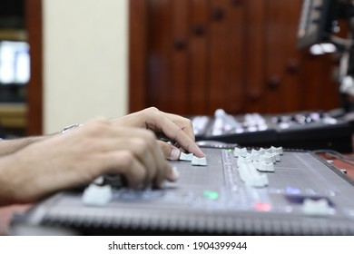 Professional light mixing console with faders and adjusting knobs - radio TV broadcasting,motion abstraction in colorful Light Show Concert