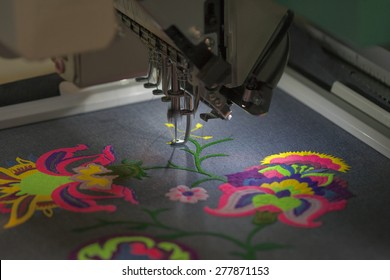 Professional machine for applying embroidery on different tissues closeup