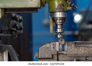 Professional machinist hand working with milling machine in metalworking factory, lathe metalworking industry concept