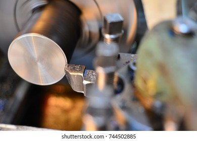 Professional machinist. Horizontal shot of a man operating lathe grinding machine metalworking industry concept copyspace