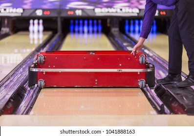 professional maintenance and oiling of a bowling lane  with a automated conditioning machine