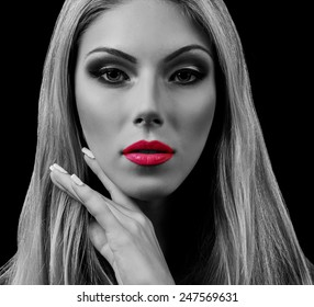 Professional Make up concept. Portrait of young beautiful woman with beauty makeup and perfect skin. Isolated on black background