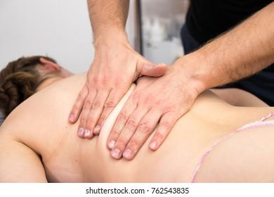 professional make massage a woman in Spa salon