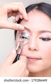 Professional Make-up artist doing glamour model makeup at work