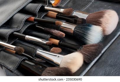 Professional make-up brush cosmetic on black background