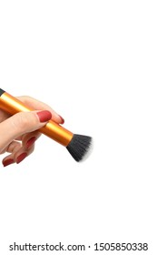 Professional makeup brush in female hand isolated on white background