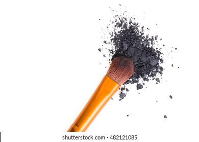 Professional makeup brush and loose powder eyeshadows isolated