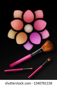 Professional make-up brush on beautiful multicolor eyeshadow palette