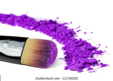 Professional make-up brush on purple crushed eyeshadow