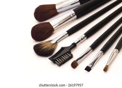 professional make-up brushes on white background