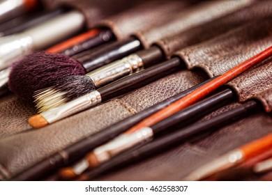Professional makeup brushes set closeup image.