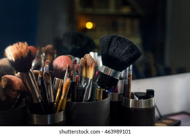 Professional makeup brushes set closeup near salon mirror