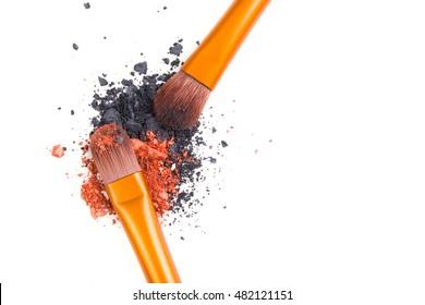 Professional makeup brushes set and loose powder eyeshadows isol