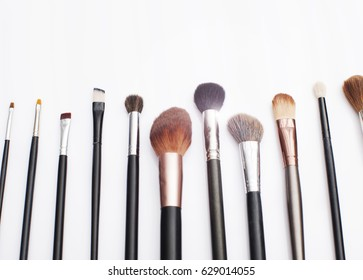 Professional makeup brushes in tube. Dirty makeup tools.