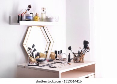 Professional makeup cosmetics on dressing table in room