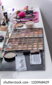 Professional makeup and cosmetics on white table