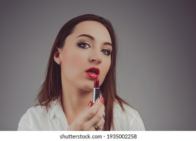 Professional Make-up. Lipgloss. Red Lipstick applying