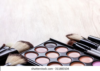 Professional makeup palette, makeup brushes, makeup products  with copyspace