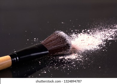 Professional makeup powder with brushes. Eyeshadow scattered