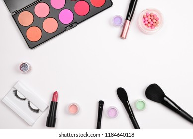 Professional makeup products with cosmetic beauty products, blushes, eye liner, eye lashes, brushes and tools.