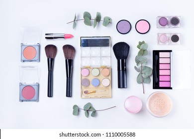 Professional makeup tools with beauty products, flat lay scene on white background