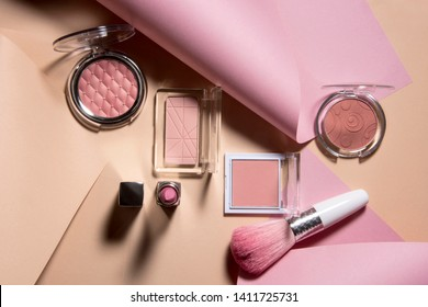 Professional makeup tools with colorful curves paper background. Abstract conception.