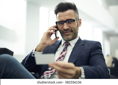 Professional male administrative manager with excellent communications skills calling to law office searching advocate to perform legal services using visit card of company with perfect reputation