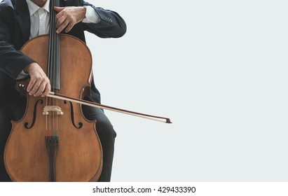 Professional male cellist playing his cello, classical music solo performance