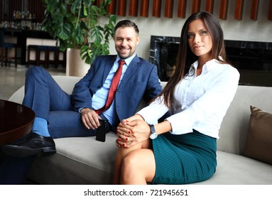 Professional male and female business partners having meeting to discuss planning strategy for common startup project thinking about attracting investors and sponsors to increase cash budget