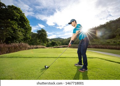 Professional male golfer are golfing in the field.