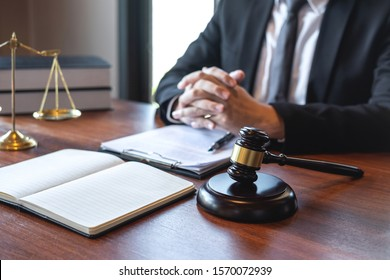 Professional male lawyer or counselor working with legal case document contract in office, law and justice, attorney, lawsuit concept.