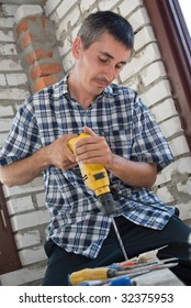 Professional man with drill.