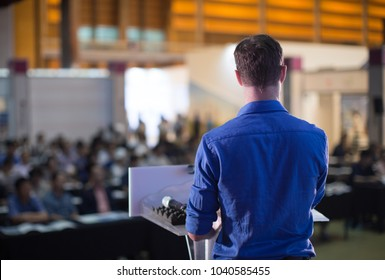 Professional Man on Stage Giving Business Presentation