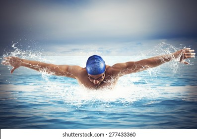 Professional man swimmer swims in open sea