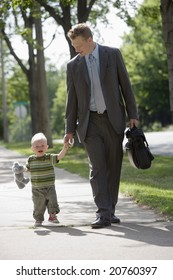 Professional man taking his child to school or daycare