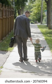 Professional man walking his child to school or daycare
