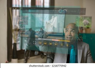 Professional man watching a futuristic video screen