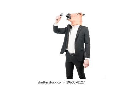 Professional man wear horse head mask in formalwear singing karaoke song to microphone isolated on white copy space, costume party.