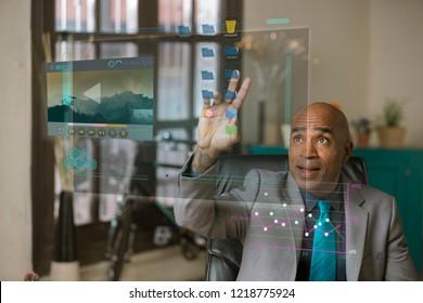 Professional man working on a futuristic computer screen