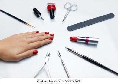 Closeup Of Beautiful Womans Nails With Red Nail Polish Care Tools