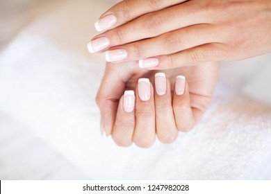 Professional manicure procedure. Nails master doing manicure in beauty studio.