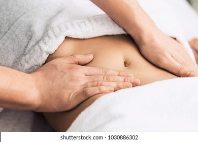 Professional massage of the abdomen.