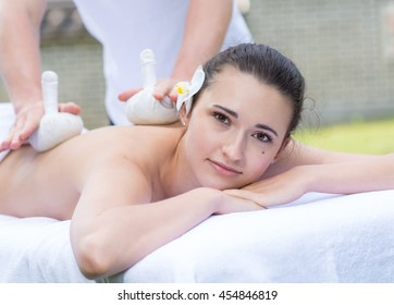Professional massage medical treatment. Professional physiotherapist master of massage is doing massage to his patient. Massage spa healthy medical concept. Thai massage indoors