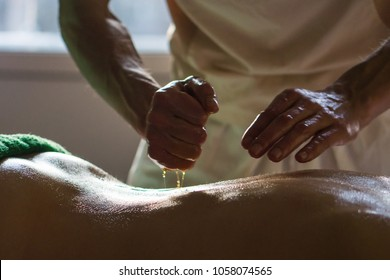 Professional Masseur Doing Deep Tissue Oiled Massage to a Girl at Ayurveda Massage Session