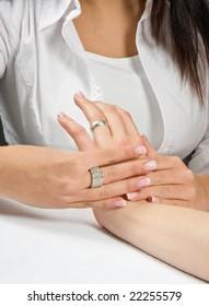Professional masseuse giving a woman a hand massage