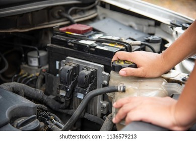 Professional mechanic is checking for engine malfunction