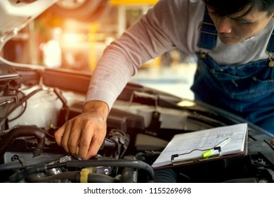 Professional mechanic working in garage. Repair service.